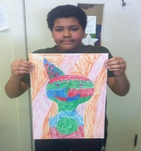Photo of student with his abstract self portrait