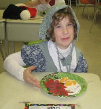 Photo of student with her pioneer feast